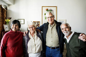 a group of seniors weighs their senior living options